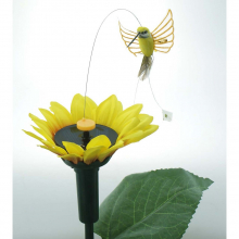 Fleur de tournesol avec un oiseau solaire virvoltant