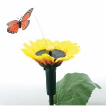 Fleur de tournesol avec un papillon solaire tournant