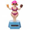 Femme en bikini solaire qui danse