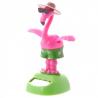 Flamant rose solaire qui danse avec des lunettes de soleil