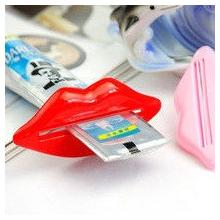 Presse tube dentifrice lèvres rose et rouge